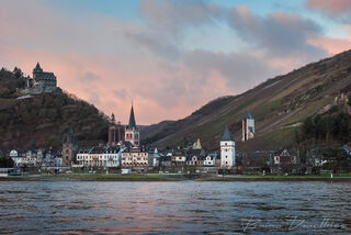View of Bacharach from the river in Hesse, Germany at dusk.