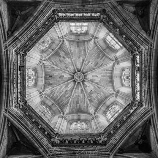 Dome of the Cathedral of Barcelona in Spain from directly below in black and white.