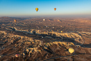 Hot air balloons viewed from the air over Cappadocia, Turkey.