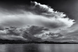 Clouds over Lake Geneva in Switzerland in black and white.