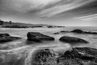 Rocky beach and coastline in Puerto Vallarta, Mexico in black and white.