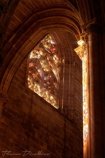 Light coming in a stained glass window at the Church of the Monastery of Saint Mary of the Victory in Batalha, Portugal.