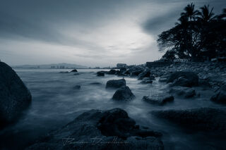 Blue-toned rocky coastline in Puerto Vallarta, Mexico at dawn.
