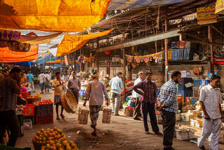 Colorful scene of customers and stalls at Crawford Market in Mumbai, India.
