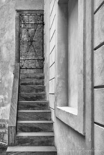 Door above stairs on the castle grounds in Prague, Czech Republic in black and white.