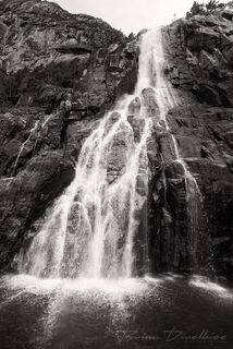 Hengjanefossen Waterfall from base in Lysefjord, Norway in black and white.