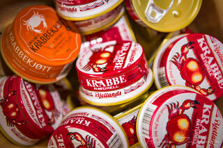 Close-up of bright containers of crab at the Bergen Market in Norway.