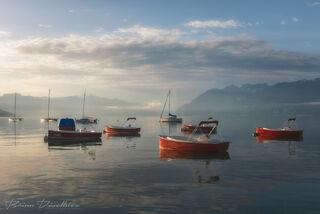 Sunrise over boats on Lake Geneva, Switzerland.