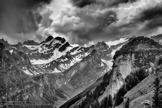 Mountains of Appenzell Innerrhoden, Switzerland from grounds of Berggasthaus Ebenalp in black and white.