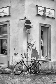 Bicycle leaning against a corner in the Old Town of Bavaria, Germany in black and white.