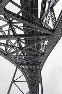 Ponte Luis Bridge in Porto, Portugal viewed from below in black and white.