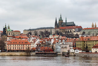 View of Prague Castle above city taken from Charles Bridge.