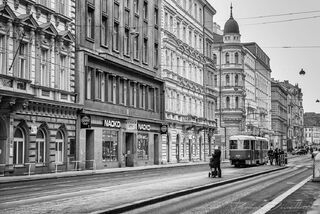 Street with trolley in Old Town of Prague in black and white.