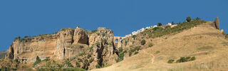 Panorama of Ronda, Spain from the valley floor.
