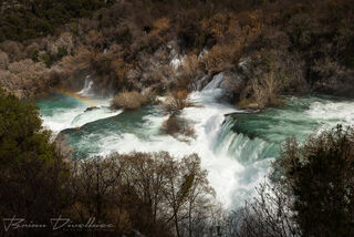 Krka River waterfalls with a rainbow viewed from above in Krka National Park, Croatia.