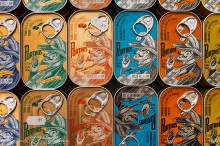 Close-up on tight rows of colorful sardine tins in Aveiro, Portugal.