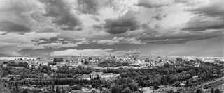 Panorama of Segovia, Spain, under storm clouds viewed from the Parador de Segovia in black and white.