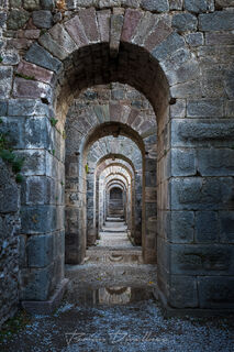 Path of blue stone arches in the Temple of Trajan in Izmir, Turkey.
