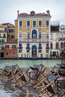 Closed patio in the rain in front of the canal in Venice, Italy.