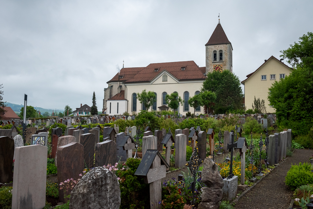 Parish Church of St. Mauritius in Appenzell, Switzerland, with the Appenzell Cemetery in the foreground.