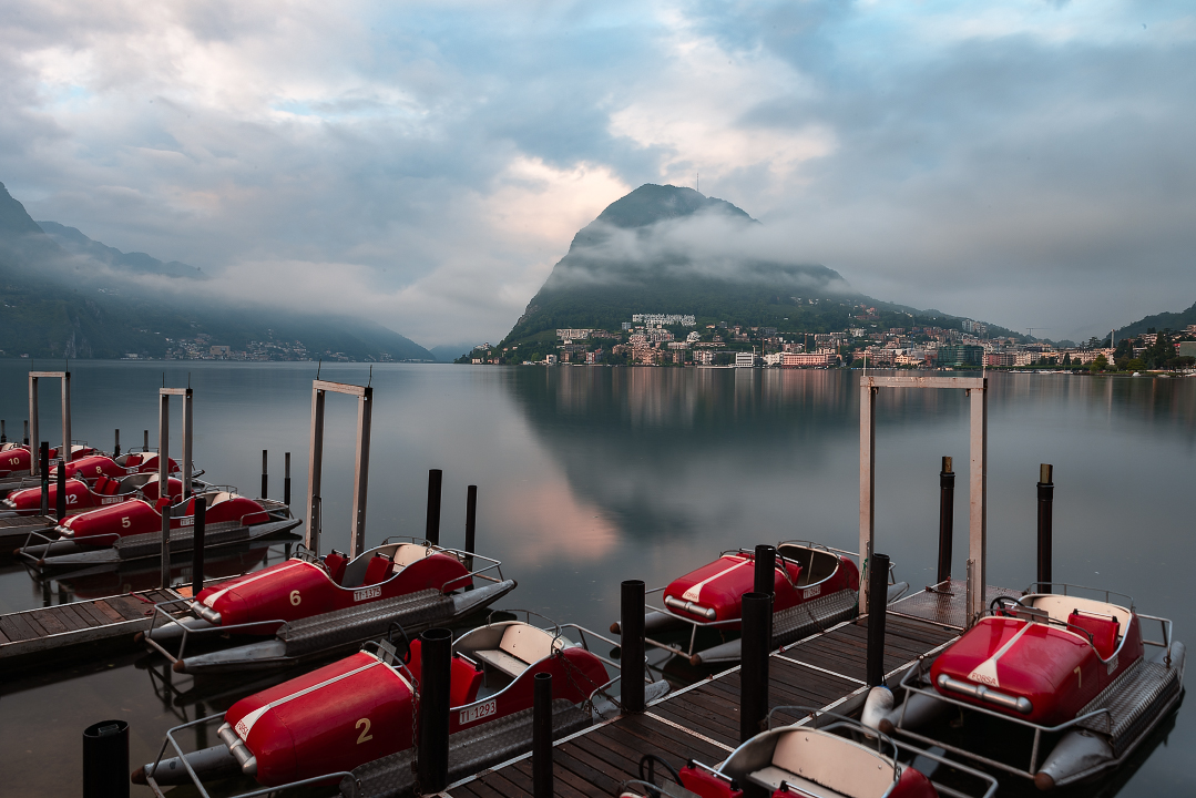 Monte San Salvatore rises sharply above Lake Lugano and the  Lugano paddleboats in the Italian section of Switzerland