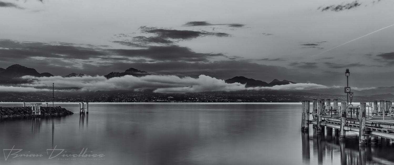 Sunrise over Lake Geneva in Switzerland in black and white.