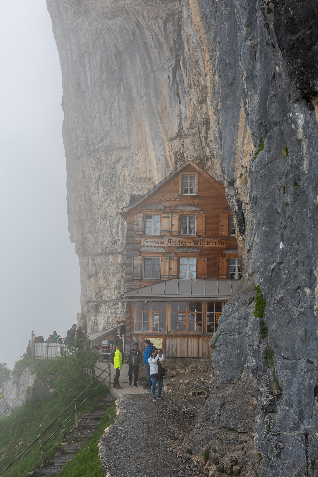 The fog-enshrouded Gasthaus Aescher Wildkirchli on Ebenalp near Appenzell, Switzerland.