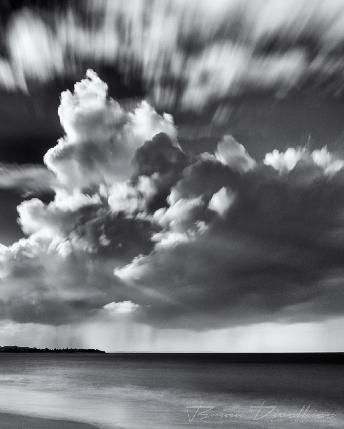 Afternoon storm clouds above the beach in Turks and Caicos in black and white.