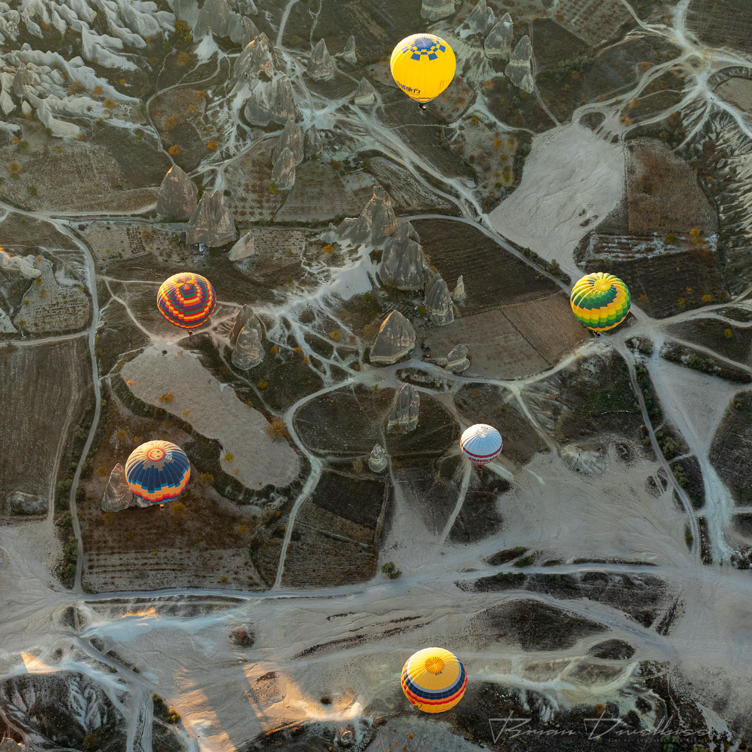 Hot air balloons viewed from above over Cappadocia, Turkey.