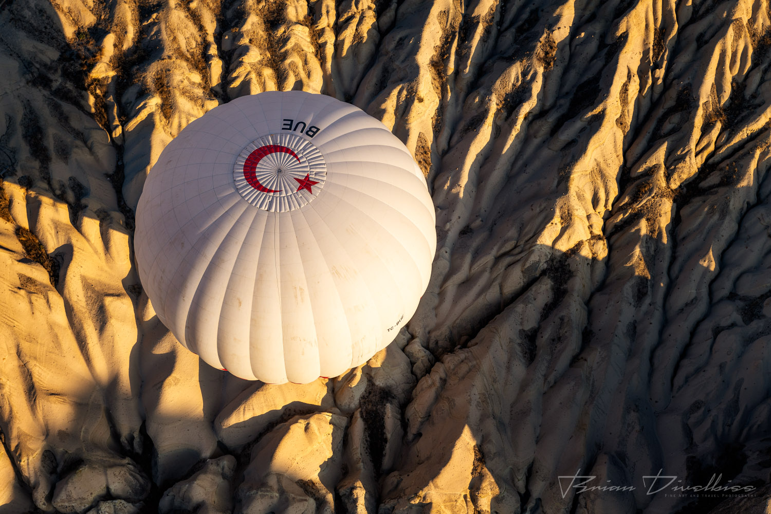 Hot air balloon viewed from above over Cappadocia, Turkey.