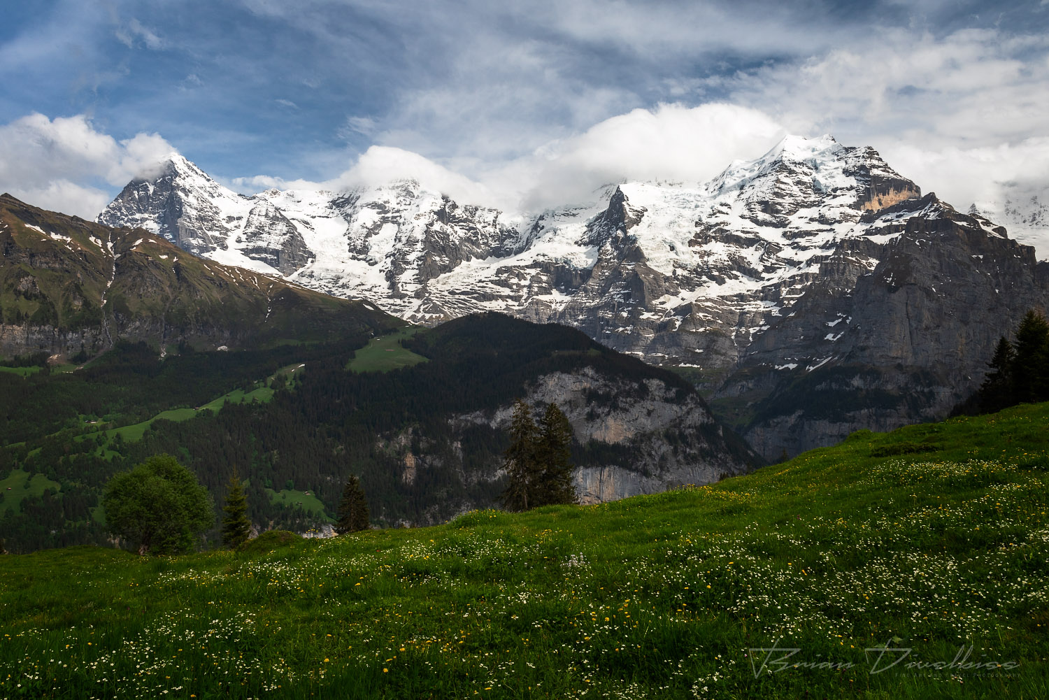 Eiger, Monch, and Jungfrau peaks from path to Murren, Switzerland.