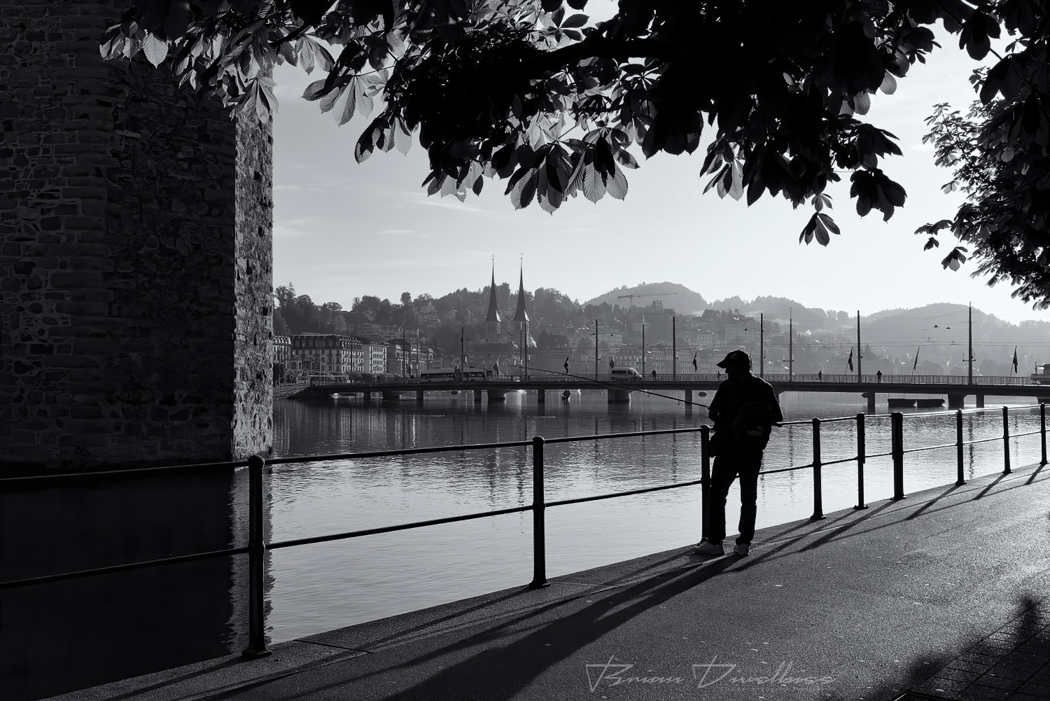 Fisherman on the Reuss River in Lucerne, Switzerland in black and white.