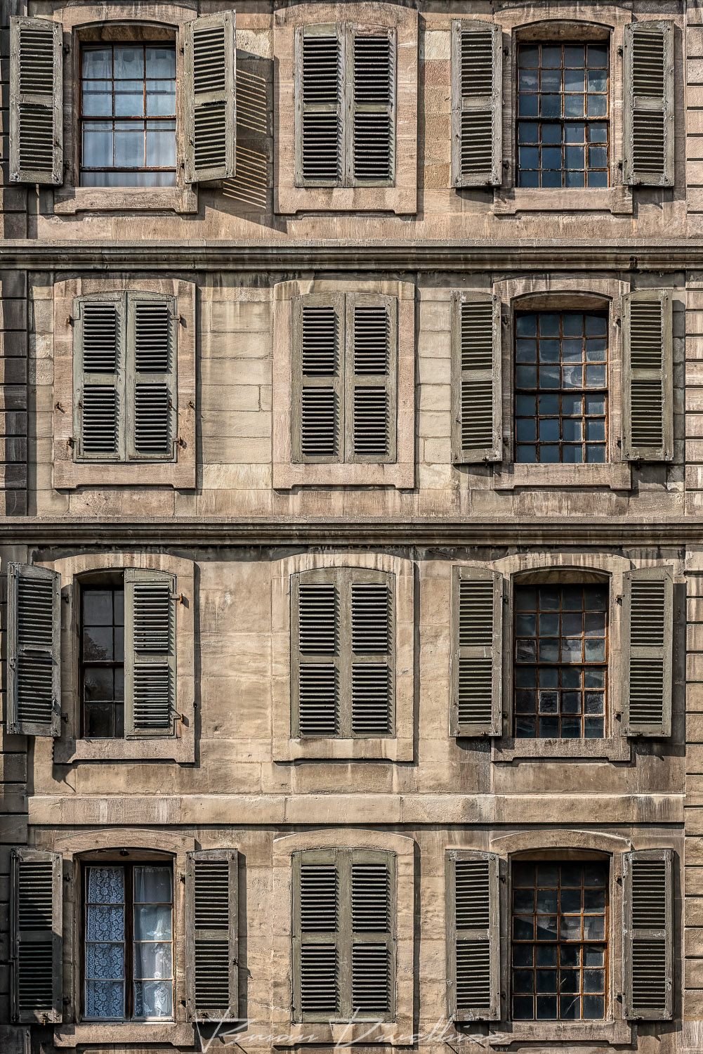 Wall of shutters in the Old City of Geneve, Switzerland.