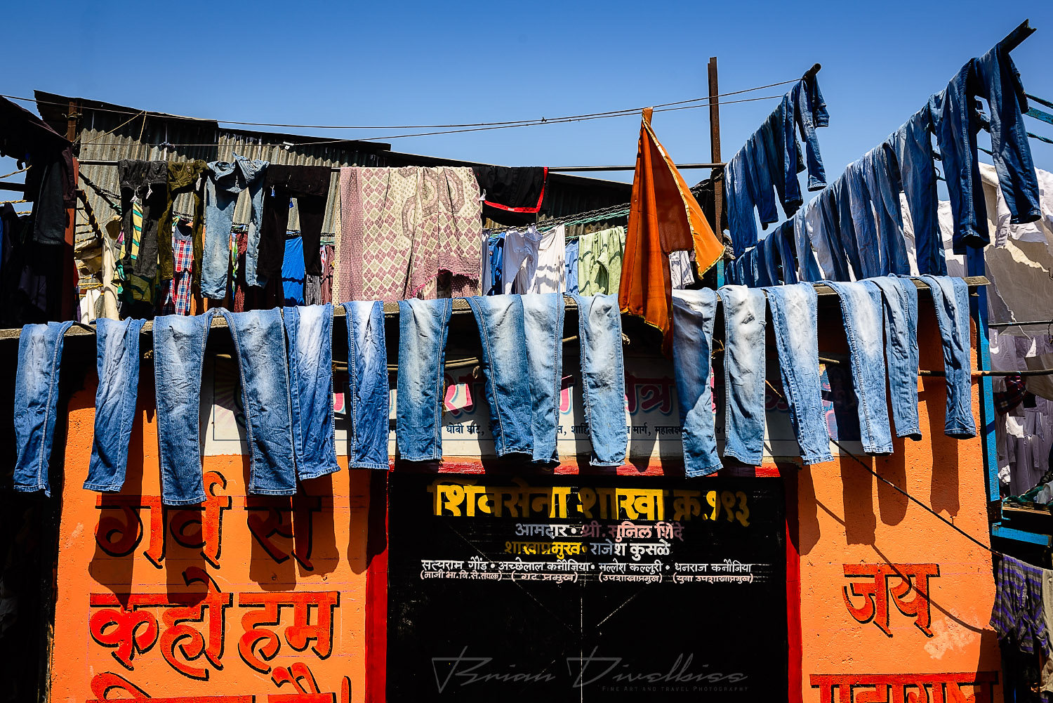 Row of jeans hanging outdoors at Dhobi Ghat in Mumbai, India.