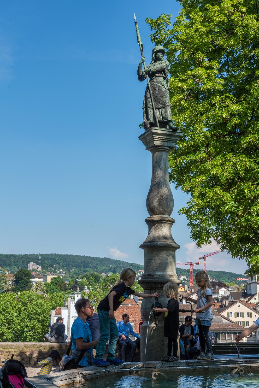 Statue of a woman in Lindenhof Square in Zurich, Switzerland.