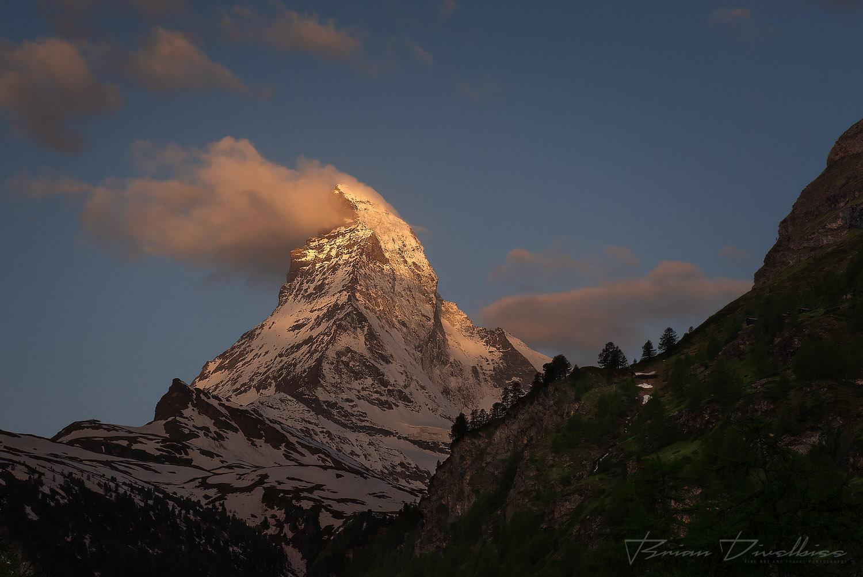 Snow blowing off the Matterhorn at dawn in Valais, Switzerland.