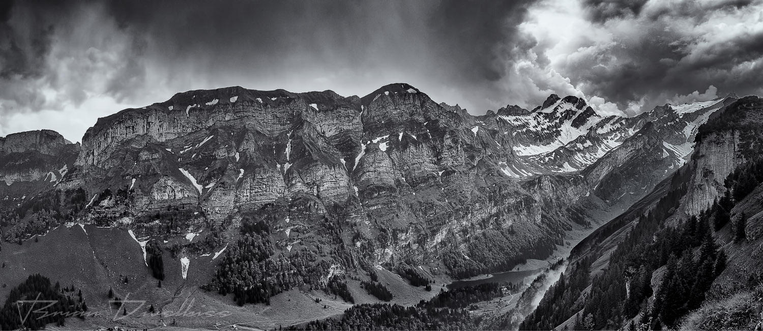 Panorama of mountains of Appenzell Innerrhoden, Switzerland from grounds of Berggasthaus Ebenalp in black and white.