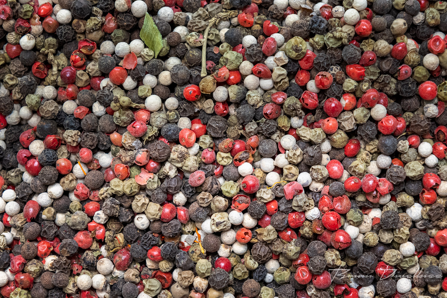 Close-up of red, white, and black peppercorns at the Spice Market in Istanbul, Turkey.