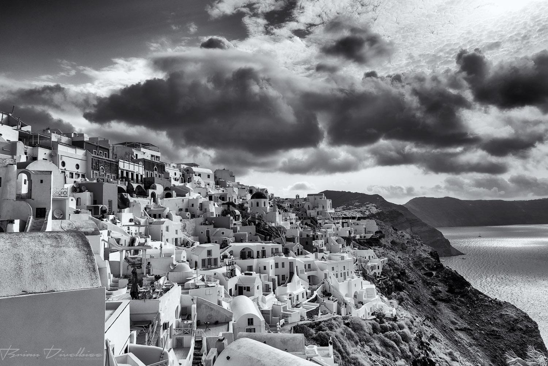Oía, Santorini over the Aegean Sea in black and white.