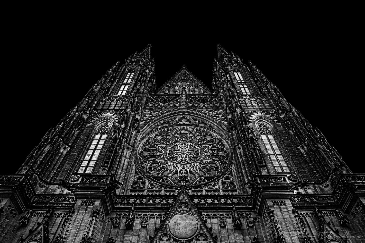 The western facade of Prague's St. Vitus Cathedral in black and white.