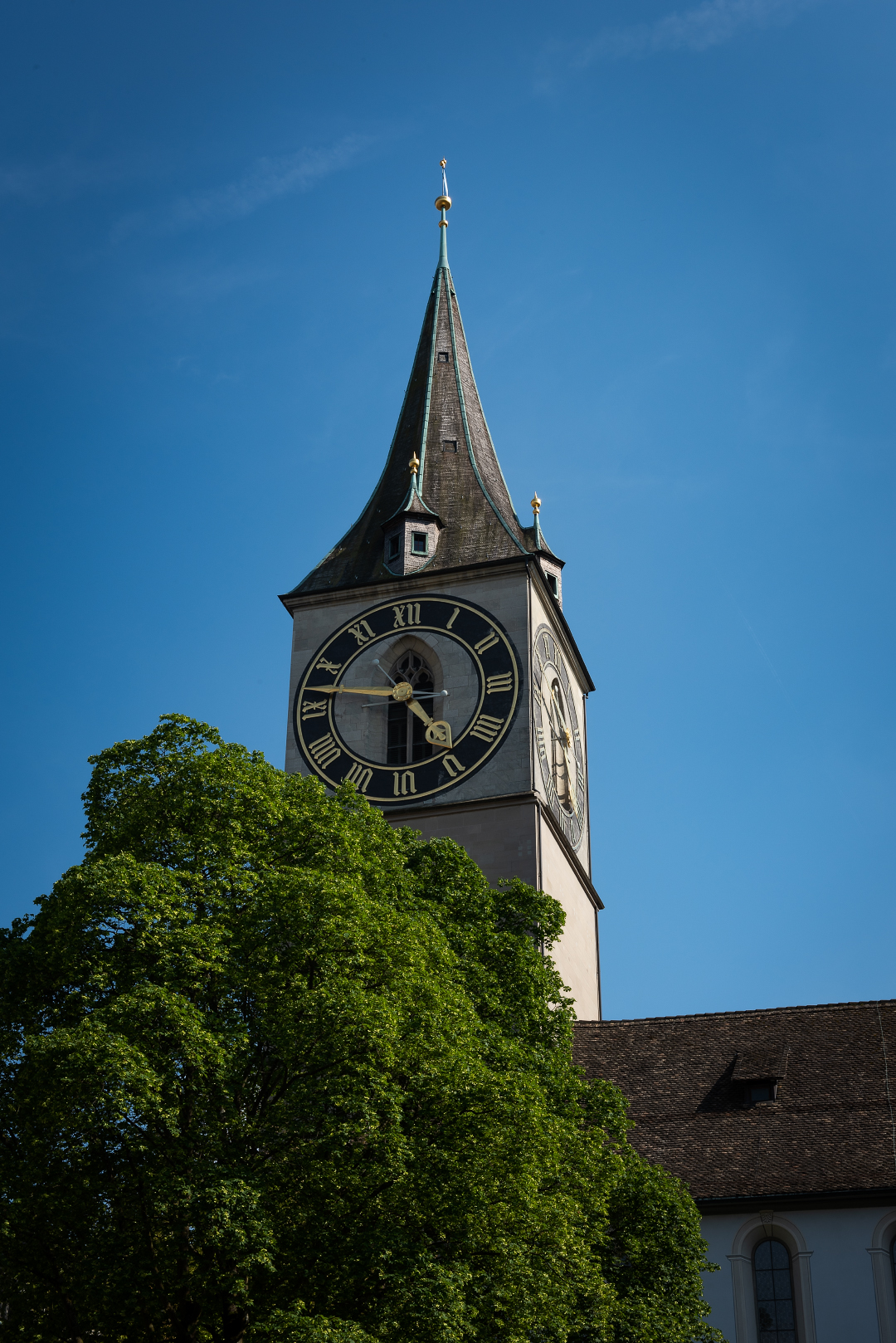 The tower of St. Peterskirche in Zurich with its iconic clock face.