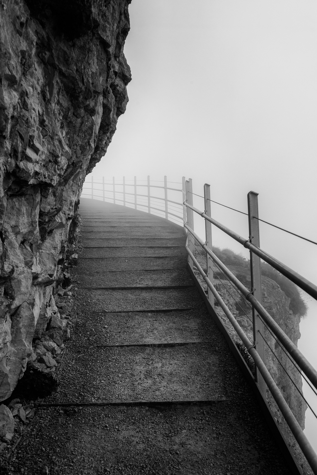 An eerie walk along the cliffside hiking back up to the Ebenalp gondola station.