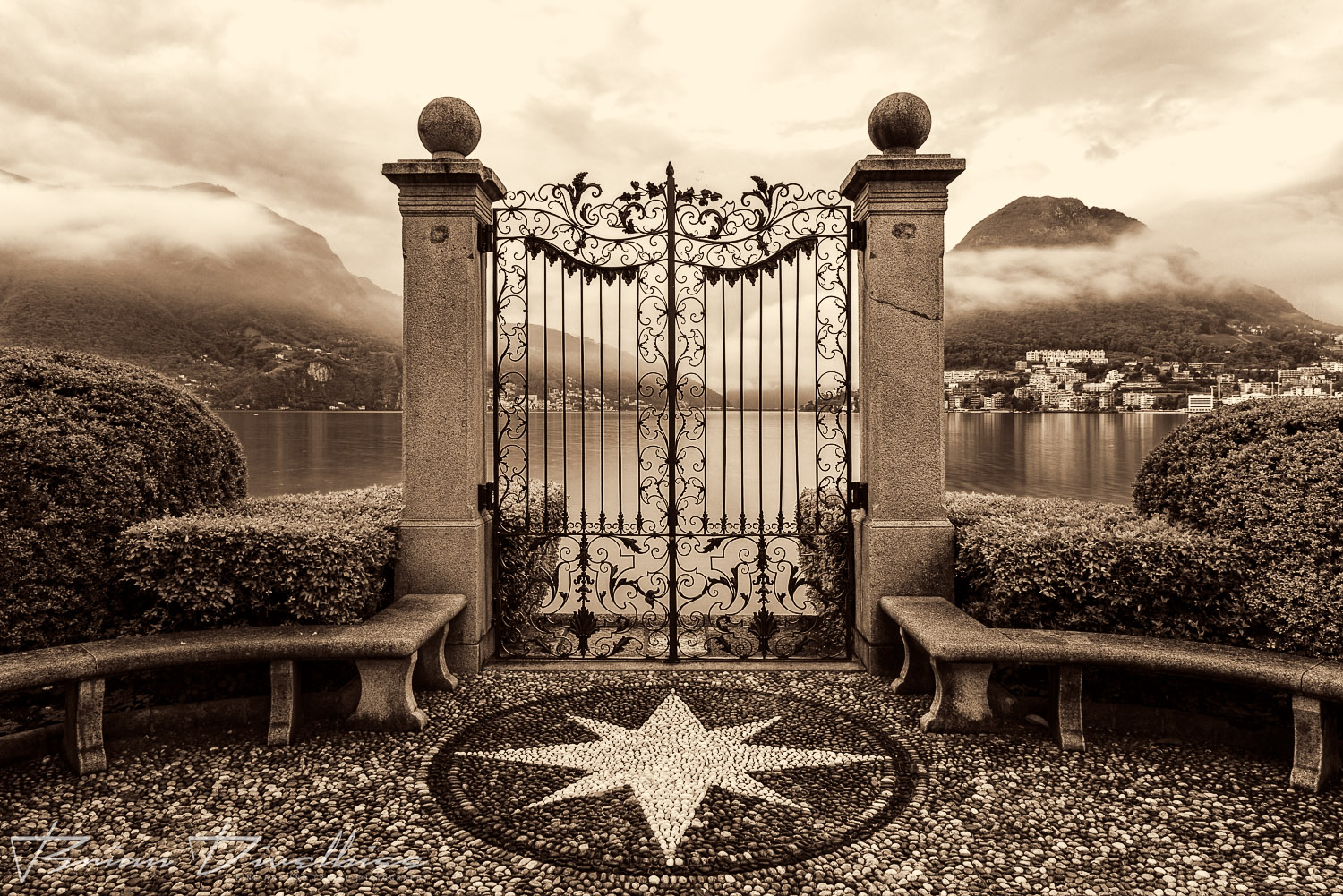 Water gate of Parco Ciani in Lugano, Switzerland in sepia.