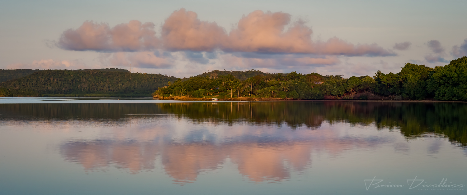 Reflection of pink clouds in the water in front of Vava'u, Tonga.